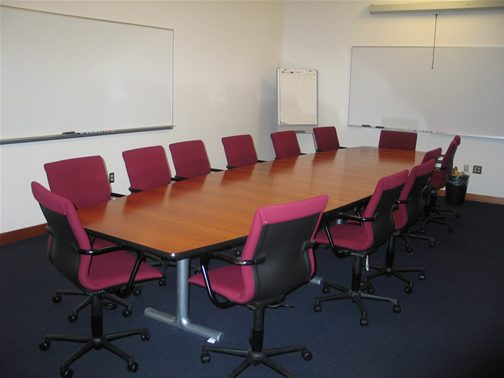 Conference Room 106 Seats 15, White Board, Pull-Down Screen